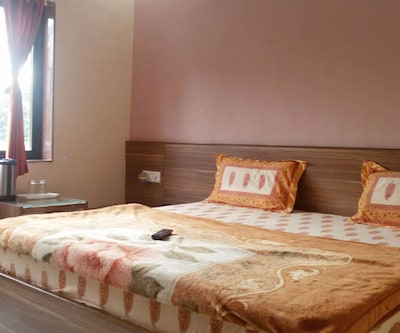 Ambika Palace, Neel Kanth Road,