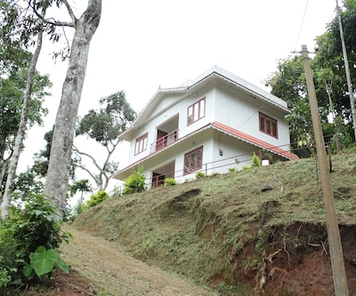 TG Stays Adit Kunchithany,Munnar