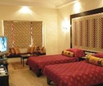 Deluxe Twin Lake View - Double, https://imgcld.yatra.com/ytimages/image/upload/c_fill,w_400,h_333/v1467531111/Domestic Hotels/Hotels_Udaipur/The Lalit Laxmi Vilas Palace Udaipur/Deluxe Twin Lake View - Double/Deluxe_Twin_Lake_View_-_Double_NMZjPw.jpg