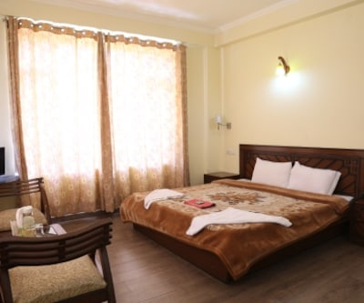 Hotel Japika Inn, Log Huts Road,