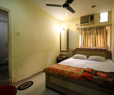 Standard Room (AC), The Standard AC Rooms offer an array of conveniences like bottled/drinking water, TV with premium channels, wakeup calls, windows that open, hot and cold running water, makeup mirror, multi-line phone, and much more. Enjoy your hotel stay with friends and family.