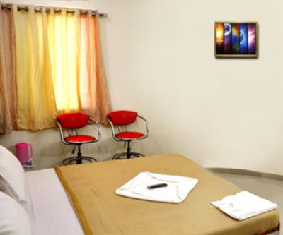 Hotel Sai Nirman, New Pimpalwadi Road,