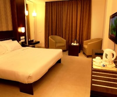 Comfort Double Room Only, https://imgcld.yatra.com/ytimages/image/upload/c_fill,w_400,h_333/v1467606817/Domestic Hotels/Hotels_Mysore/Sunflower Hotel/Comfort Double/Comfort_Double_JXk1AO.jpg