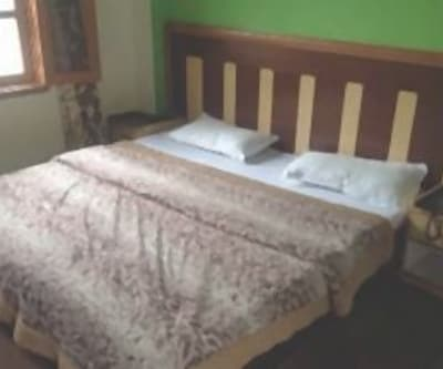 Super Deluxe Room, These rooms are well furnished and are equipped with amenities such as television, wardrobe, coffee table with chairs and bottled drinking water. The attached bathroom has hot and cold running water for its guests.