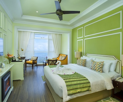 Tropic Green, Tropical Green Rooms have ceiling fan, adjustable window, television set and attached bathroom.