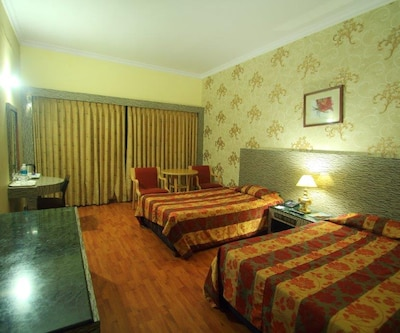 Premium - Breakfast  Wi-fi, This is a double room with an attached bathroom and a private balcony that overlooks the magnificent hill station. It has amenities that include an electronic direct dial phone facility, colour T.V. with satellite transmission and room service.