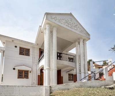 Well-appointed boutique stay, fronted by tea gardens,Ooty