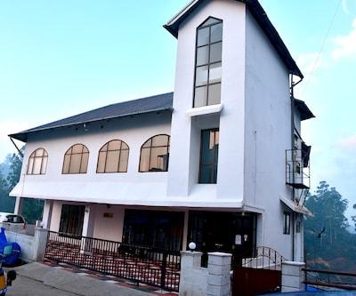 Natura Inn,Munnar