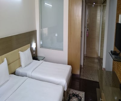 Twin Bedroom Double Room With Breakfast, Twin Bedroom has amenities such as air-conditioner, tea/coffee maker, mini-bar, bottled drinking water, wardrobe and attached bathroom with toiletries and hot/cold water supply.
