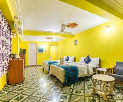 Standard AC Triple room with partial Sea View Room Only, https://imgcld.yatra.com/ytimages/image/upload/c_fill,w_400,h_333/v1510826684/Hotel/Goa/0000312878/103382149_J4gfIi.jpg