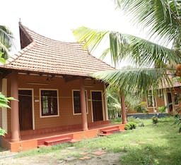 Hotel Dazzle Dew Heritage Holiday Resort