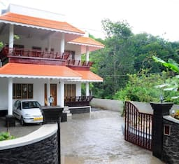 Hotel Cottages In Thekkaddy