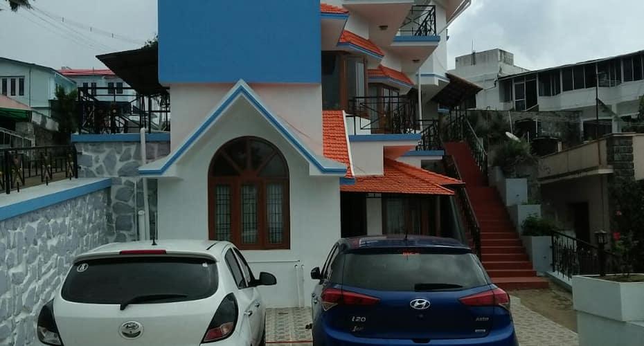 Blue R.T.C Cottage, MM Street,