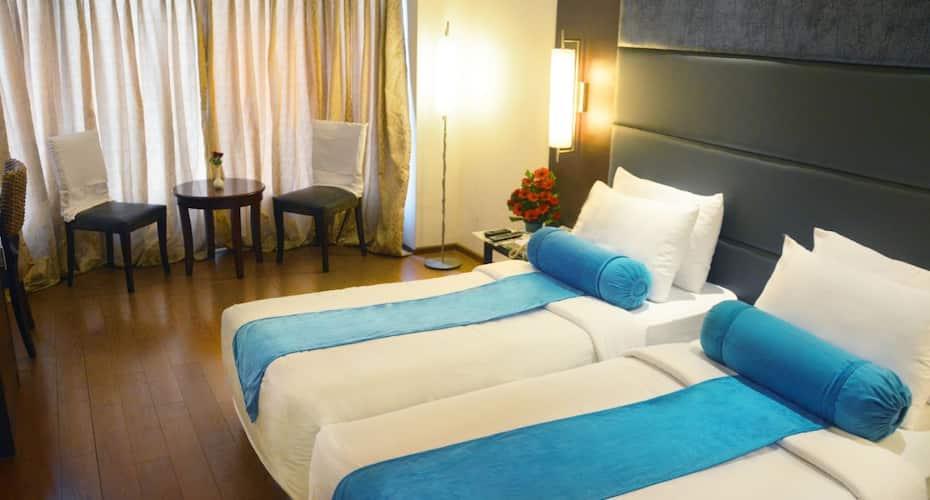 Ashraya International Hotel, Infantry Road,