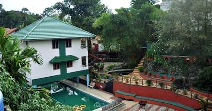 Hotels with swimming pool in kalpetta wayanad night for Resorts in wayanad with swimming pool